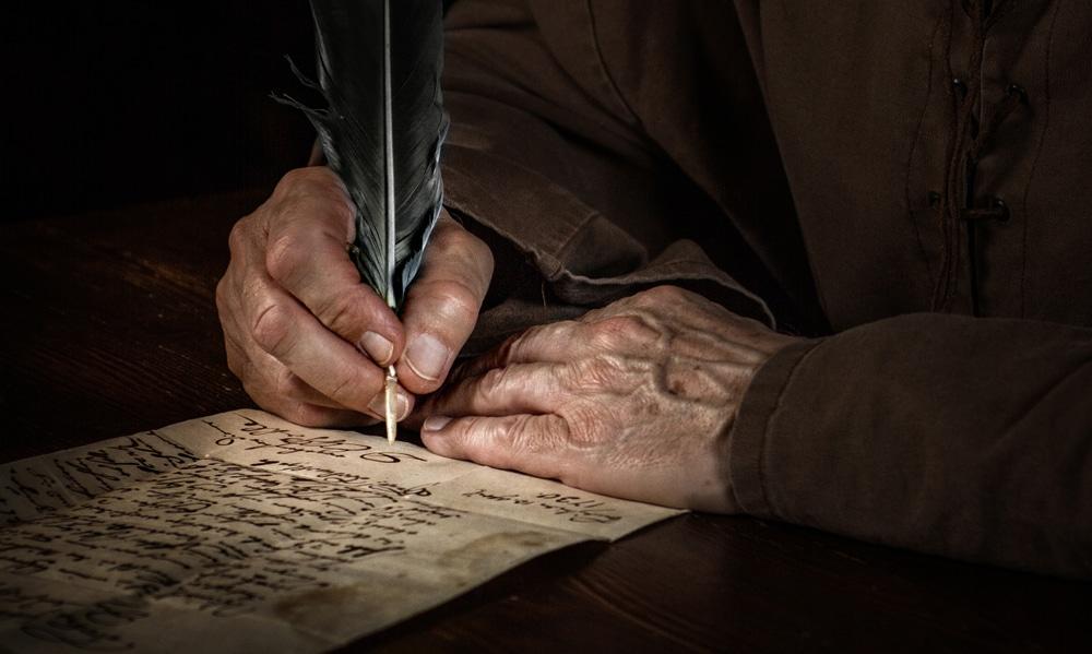 homme qui pratique l'écriture automatique